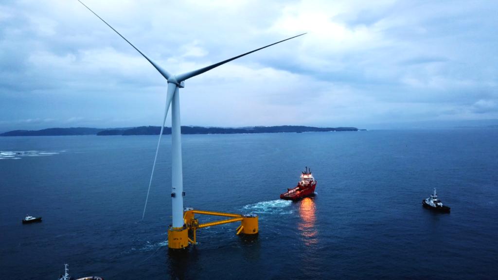 Floating wind turbine being towed